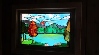 Huddleston cabin photo - Local artist made beautiful stained glass window which mimics the outside view