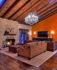 Carlsbad house photo - Great room fireplace with large comfortable couches and french doors to pool.