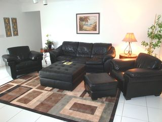 Fort Lauderdale house photo - Living room has Natuzzi leather easy chairs and sofa.