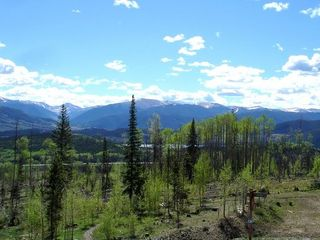 Silverthorne townhome photo - Spring view of surrounding peaks and Lake Dillon.