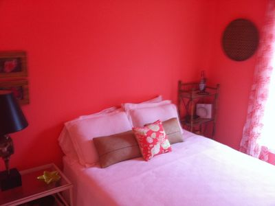 Coral Room on the main level, Queen bed. A calm and cool retreat.