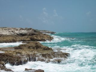 San Salvador house photo - rocks/high surf on south end of island