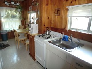 Muskegon cottage photo - Kitchen Is Well Stocked With Utensils, Cookware, Appliances, Coffee & Spices.