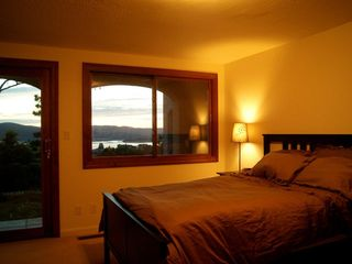 Tiburon house photo - Downstairs bedroom with sunset views over the bay and mountains. Slider to lawn