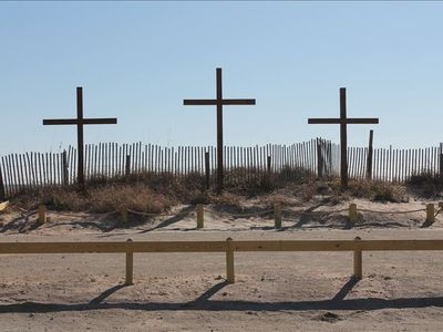 THREE CROSSES ON BEACH