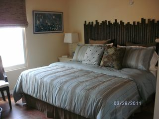 Cayman Brac house photo - Second bedroom with custom bamboo headboard on king size bed.