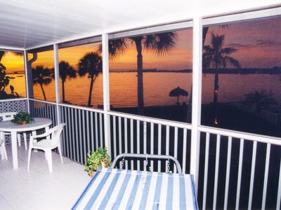 Upstairs condo large screened porch beach sunset view