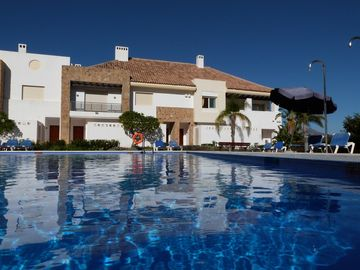 La Cala de Mijas house rental - Nearest pool and townhouse (on right by palm tree)