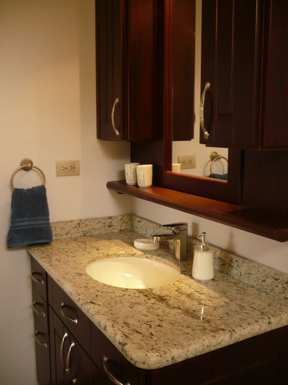 The two bathrooms feature all granite counter tops and luxury amenities..
