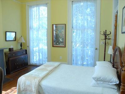 MAGAZINE ST ENTIRE AUTHENTIC 4 BEDROOM GREEK REVIVAL HOUSE - Front upstairs bedroom 2 with a Queen Bed