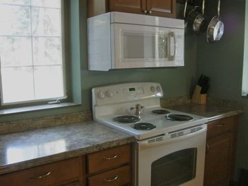 Closeup view of stove and countertop in kitchen