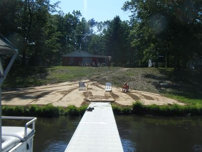 View of beach and cottage from dock