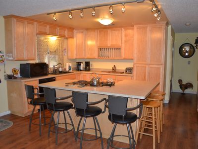 The brand new kitchen has all the creature comforts of home and seats seven.