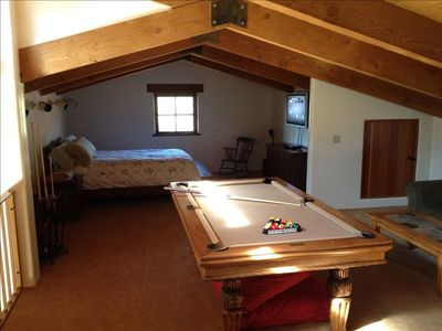 Loft with queen bed and pool table.