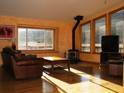 View of the living room with lots of light and windows with views. Wood-Stove.