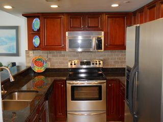 Garden City Beach condo photo - Granite countertops and stainless steel appliances