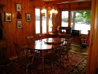 Sunapee cottage photo - Dining area overlooking lake now has 8 chairs and 2 extra