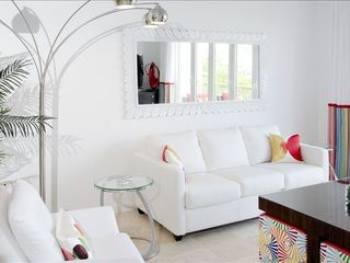 Dawn Beach house photo - Living Room with designer furniture. Sofa is a queen sleeper.