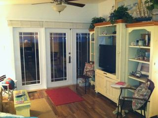 French doors leading to screen porch from living room