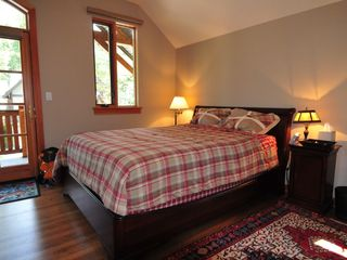 Canmore house photo - Example of secondary bedroom with queen sleigh bed and shared balcony
