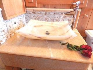 Heavenly Valley condo photo - The baths offer a carved stone sink, heated toilet seats and mosaic stone floors