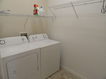 Laundry room with new washer & dryer. Laundry soap & other supplies provided.
