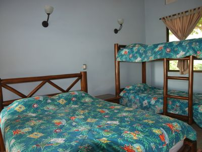 Bunk bed/Queen room for kids ... or a family of four! All steps from the pool.