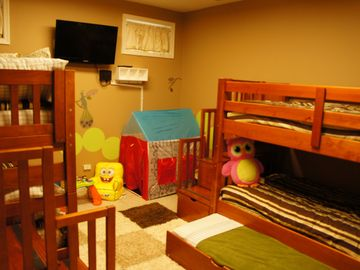 Kids bedroom with 2 bunk beds with trundles. Sleeps 6.