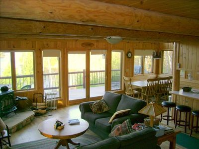 Ely cabin rental - Main level living room w/ walk-out deck