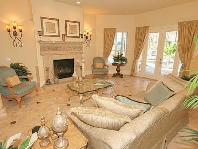 Formal entrance lounge with fireplace, drinks bar and doors to the pool area.