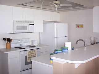 Cape Canaveral condo photo - Full kitchen all utentils and cookware nice place to have dinner