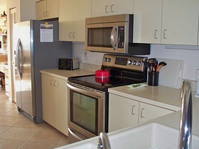 Fully equipped and well-stocked kitchen with all new appliances and fixtures.