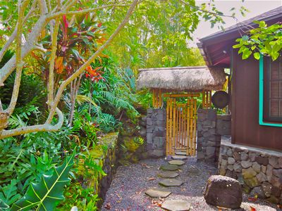 Circling the cottage this path leads to bamboo gate opening to the Shower Grotto