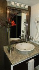 Puerto Vallarta apartment photo - Beautiful bath room with granite counter, shower and hair dryer