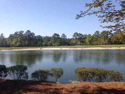view from screened porch - lake,  sand trap & 4th fairway at True Blue