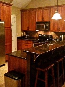 Fully stocked kitchen has a pantry for your food/snacks, and seats 5 at the bar
