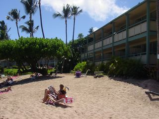 Napili condo photo - People sunbathing in front of our building.