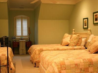 Large upstairs bedroom with 2 queens and a twin trundle bed