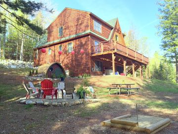 Newry chalet rental - Enjoy the yard and the Horseshoe Pit, Fire Pit, and new Hobbit Hole Playhouse.