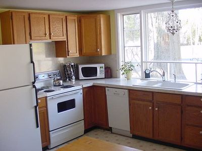 The kitchen boasts a new dishwasher, sink, faucet and crystal light fixture.