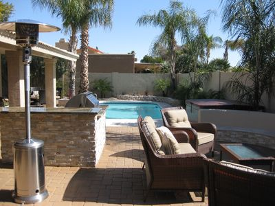 Kierland Scottsdale house rental - Entertainer's backyard with outdoor wicker seating, granite top BBQ and Bar,pool