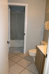 The Summit condo photo - The newly remodeled bathroom as accessed through the hallway.