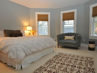 Lenox house photo - Spacious master bedroom has plenty of light and king-sized bed