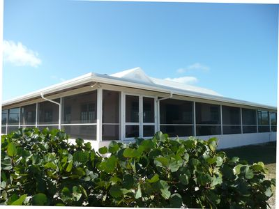This is a large ranch style home with large screened verandas on all sides.
