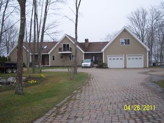 Westport Island house photo - House on the entry side with paved driveway and pond
