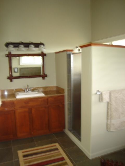 Huge tile shower and granite vanity.