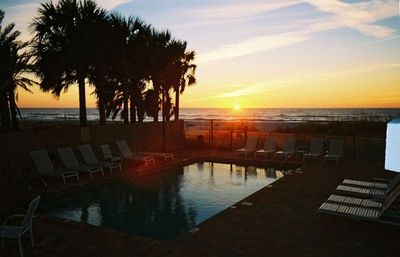 Enjoy sunsets by the beachfront  pool