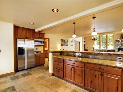 Kitchen with Slate Tile and Granite Counter Tops