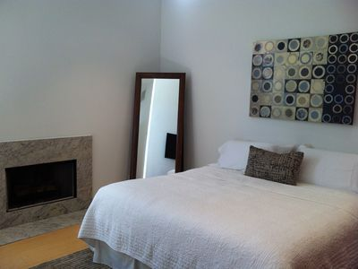 Casita bedroom with fireplace and king bed.