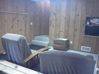 Crystal Mountain, Thompsonville cabin photo - Ski storage and TV sitting area in basement.